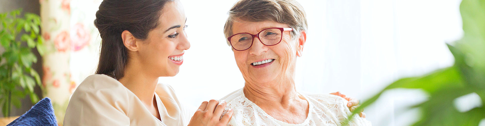 elderly with glasses smiling